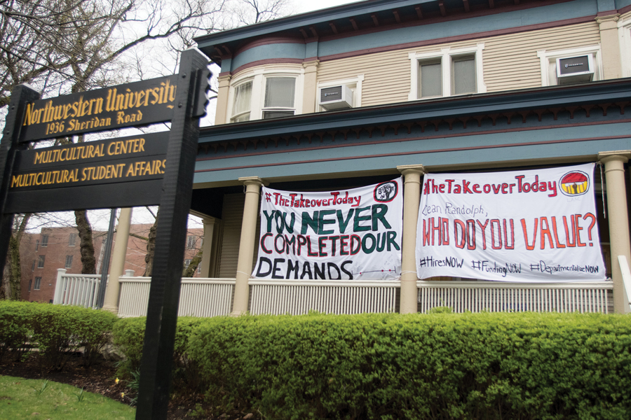 Banners urging University action in commemoration of the Bursar's Office Takeover hang outside the Multicultural Center. On Thursday, students released a list of 47 demands for improvement in black student experiences, departmentalization efforts and the campus dining transition.