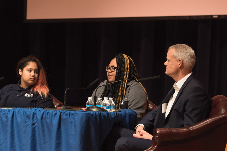 Evanston Township High School student Rie'onna Holman speaks at a Family Action Network Fellows event Wednesday. Panelists discussed mass shootings and gun violence in Chicago.