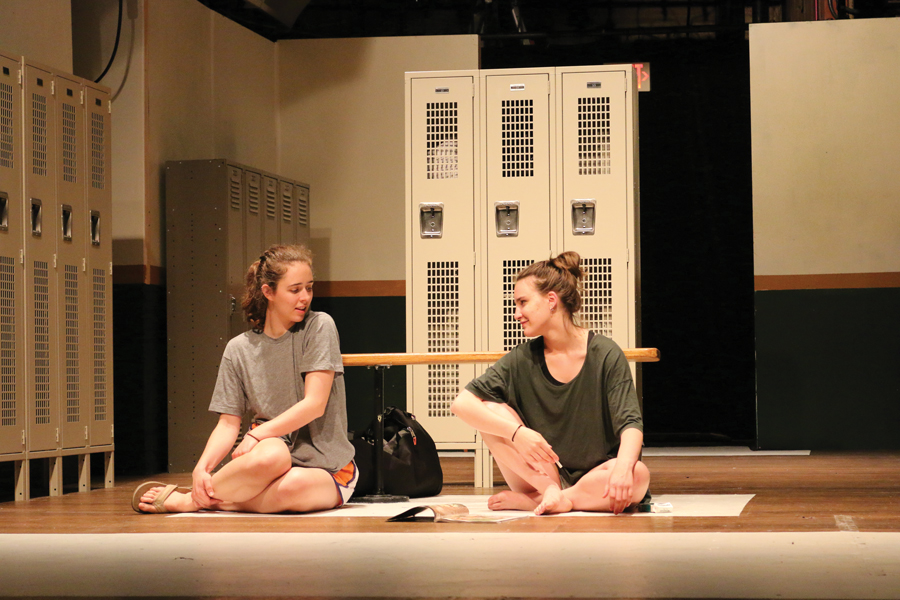 "Two actors rehearse onstage for Arts Alliance's spring show ""Dry Land."" The play follows teenagers Amy and Ester who develop a friendship after Amy asks Ester to help her miscarry an unwanted pregnancy."