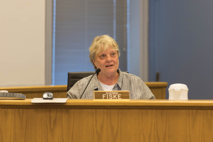 Ald. Judy Fiske (1st) speaks at a council meeting. Fiske voted against the development of a 17-story active living facility due to concerns about the impact on traffic.