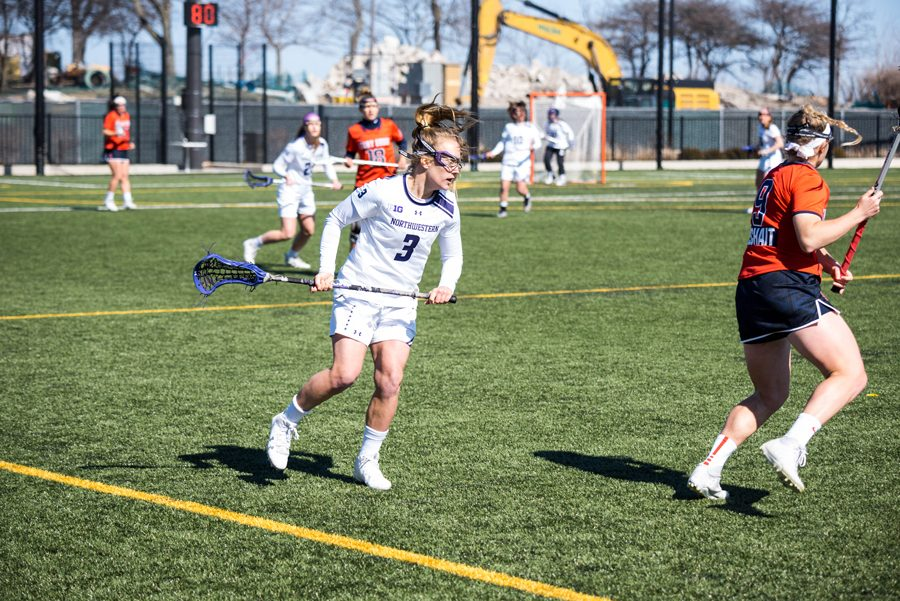 Shelby Fredericks eyes an opponent. Fredericks left Northwestern lacrosse with the most draw controls in program history.