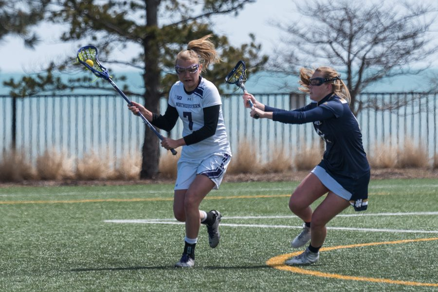 Sheila Nesselbush looks to evade a defender. The senior midfielder scored 14 goals in two games this weekend to help Northwestern advance through the NCAA Regionals.