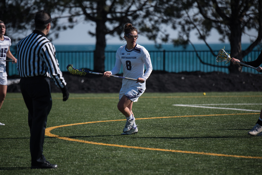 Danita Stroup looks to make a pass. The senior attacker scored 9 goals in two games in last year's NCAA Tournament and will be looking for more this weekend.