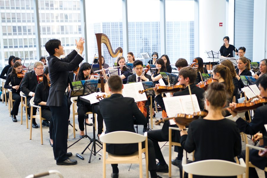 The Northwestern Medical Orchestra performs at its inaugural concert in the Shirley Ryan AbilityLab on May 1. The orchestra features everyone from Feinberg students and postdocs to faculty, staff and local alumni.