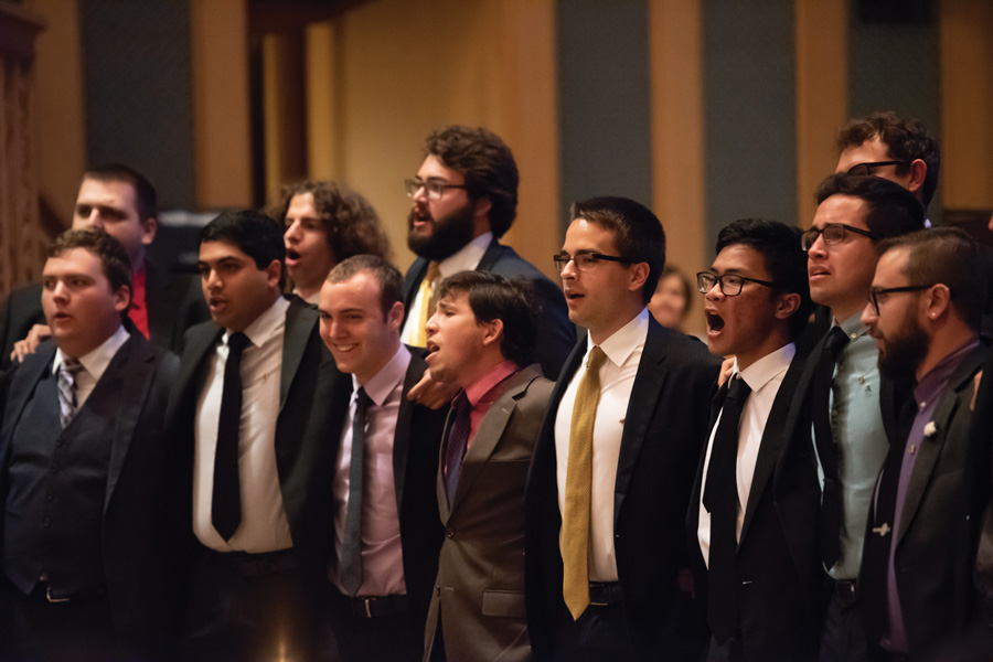 Members of Phi Mu Alpha perform at a memorial service for Ananya Agrawal, a Weinberg senior who died Saturday night. More than 100 community members gathered in Alice Millar Chapel on Wednesday evening for the service.
