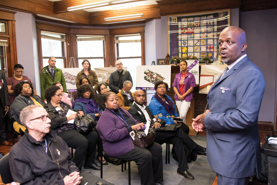 Jeffrey Sterling, president of the NU Black Alumni Association, speaks at the Black House. Students, alumni and University officials gathered Thursday for a symbolic groundbreaking ceremony on the 50th anniversary of the Bursar's Office Takeover.