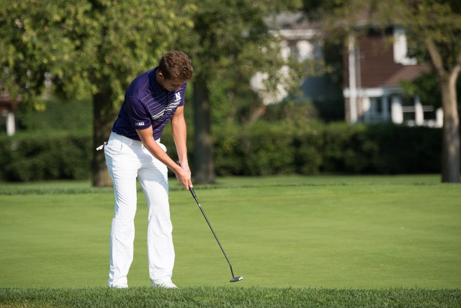 Ryan Lumsden hits a putt. After Friday's first round, Lumsden individually was tied for first in the tournament.