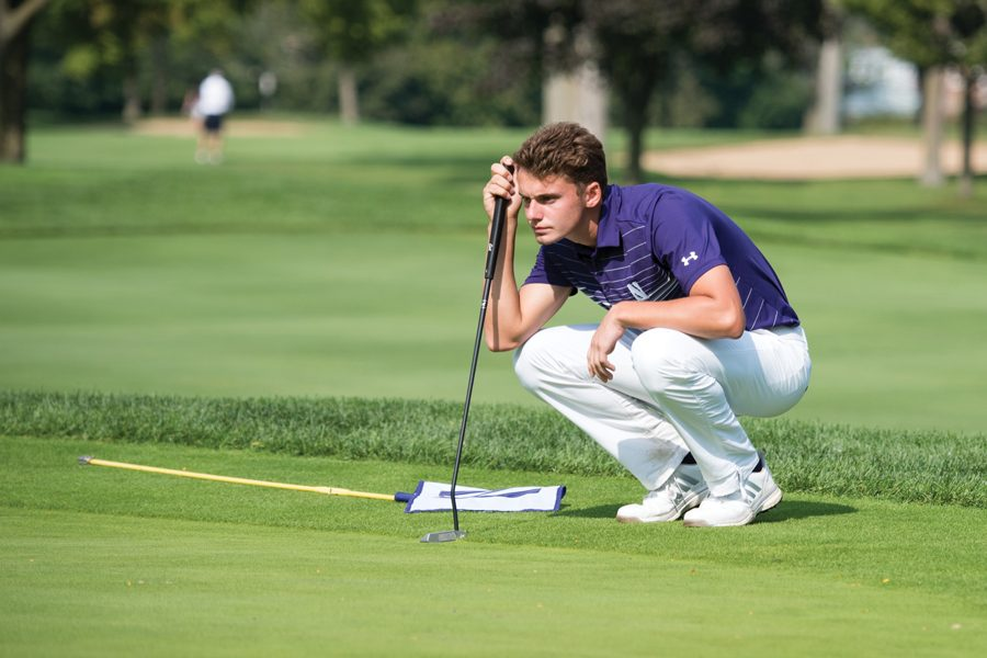 Ryan+Lumsden+lines+up+a+putt+while+on+the+green.+The+junior+finished+the+Columbus+Regional+at+2-under%2C+the+best+score+of+any+Wildcat.%0A