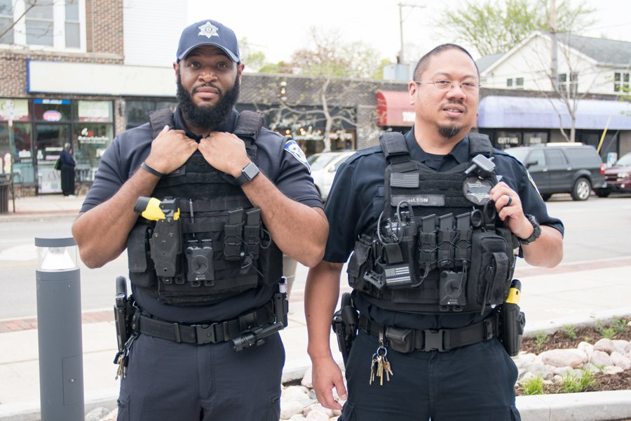 Officer Adam Howard stands with Officer Ervin de Leon in Evanston's 5th Ward. Howard will receive the Officer of the Year award Wednesday.