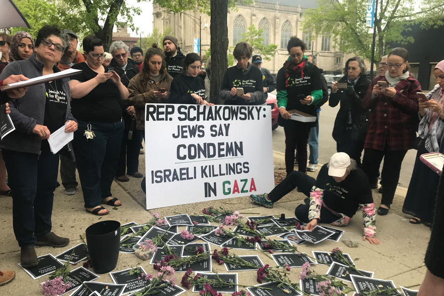 Jewish Voice for Peace Chicago demonstrators hold a sign Friday calling for U.S. Rep. Jan Schakowsky (D-Ill.) to condemn killings in Gaza. The group gathered in front of Schakowsky's district office.