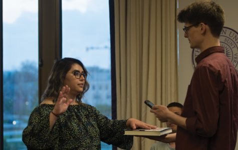 Julia Shenkman is sworn in as chief of staff at Wednesday's Senate. The Weinberg junior introduced election commission guidelines reform during the meeting.