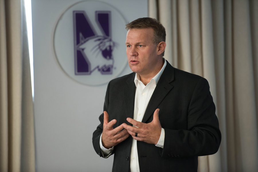 Karl Behrens, chief operations officer of the Compass Group project division, speaks at ASG Senate on Wednesday. Behrens presented floor plans and sketches for dining hall renovations.