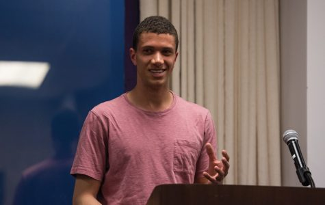 Tyler Washington speaks during ASG Senate. The Weinberg junior was one of nine vice presidents confirmed at Wednesday's meeting.