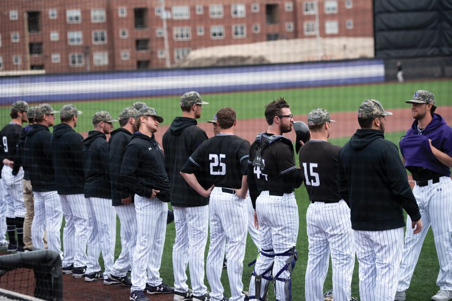 The+2018+Northwestern+baseball+team+lines+up+at+the+start+of+a+game.+The+team+has+struggled+this+season%2C+but+numerous+alumni+see+big+things+in+its+future.