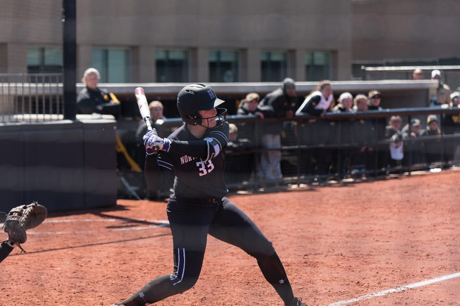 Kenna+Wilkey+takes+a+swing.+The+sophomore+drove+in+three+runs+in+Sunday%E2%80%99s+win+over+Iowa.
