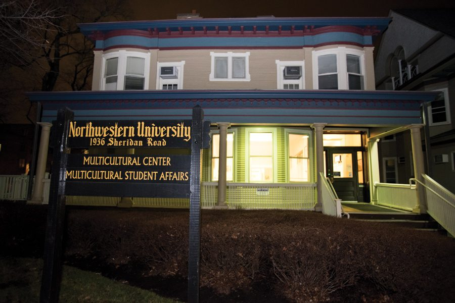 A house that is the Northwestern Multicultural Center with a sign in front of it stating its address