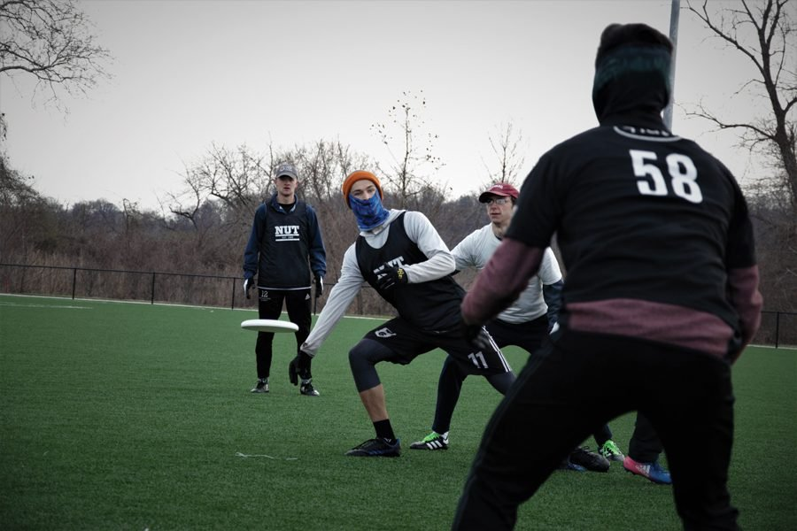 Northwestern Ultimate's Jeff Holm (#11) throws to Theo Bisdikian (#58) during a game earlier this season. The team is headed to Nationals for the first time ever later this month.