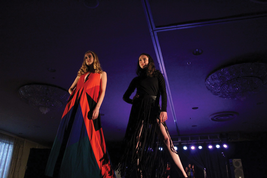 Student models Kelly O'Conor (left) and Gina Johnson pose on the runway at last year's UNITY fashion show. The two will model at this year's #SupportCPS show, which features the work of student designers.