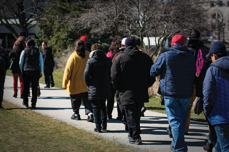 Northwestern's Sodexo and Aramark employees march in April to present a petition asking the companies to help with the transition to Compass Group North America. The workers' union, UNITE HERE Local 1, and Compass came to an agreement Wednesday.