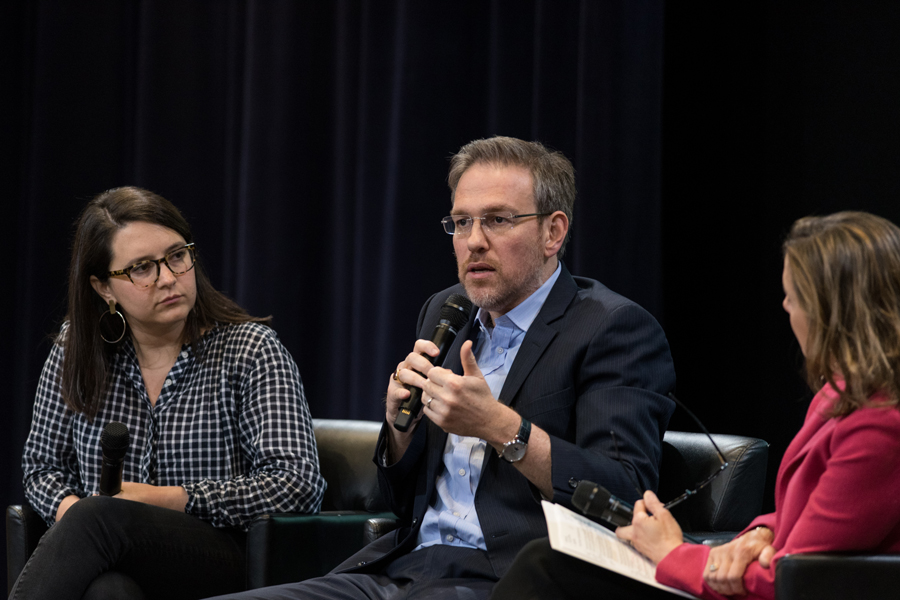 New York Times columnist Bret Stephens (center) speaks at an event Monday. Stephens and his colleague Bari Weiss (left) spoke about challenging discourse and the importance of free speech.