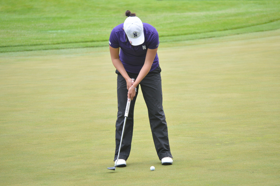 Hannah Kim lines up a put. The senior helped lead Northwestern back to NCAA Tournament Championship match play.
