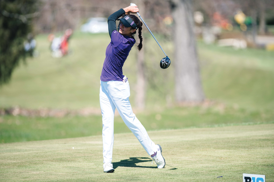 Brooke Riley watches her drive. Riley turned in a 6-under score Wednesday to help Northwestern advance through NCAA Regionals.