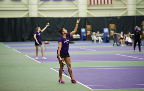 Rheeya Doshi prepares to serve. The junior has been an unlikely star in the postseason thus far.