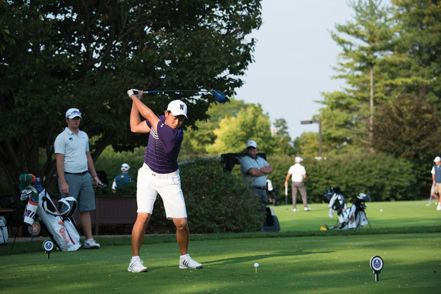 Dylan Wu tees off. The senior finished his Northwestern career with the second-best stroke average in school history.