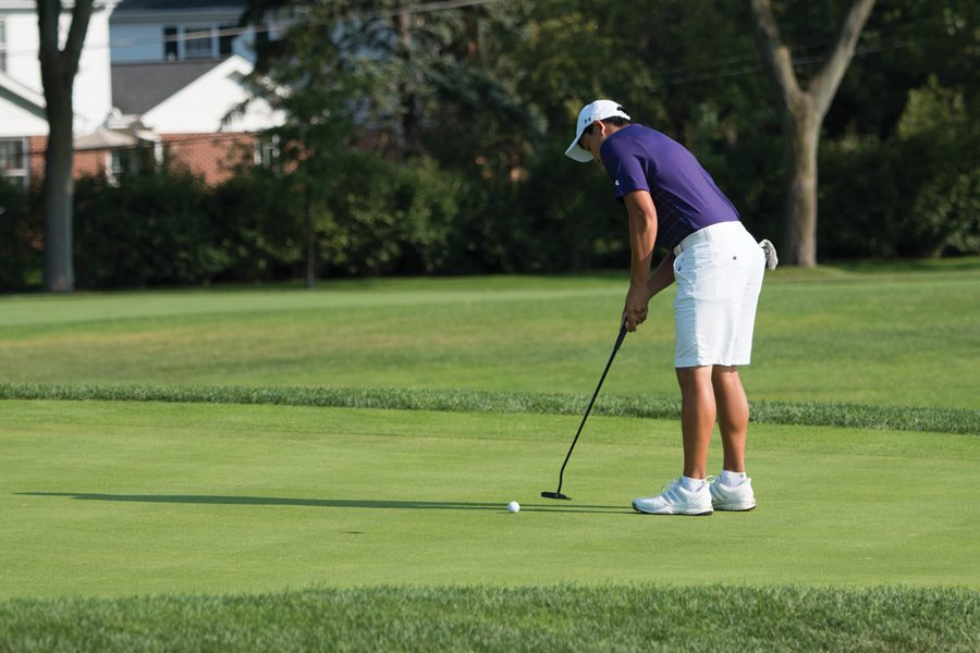 Dylan Wu lines up a putt during his freshman season. The golfer led the team in scoring average for the 2014-15 season.