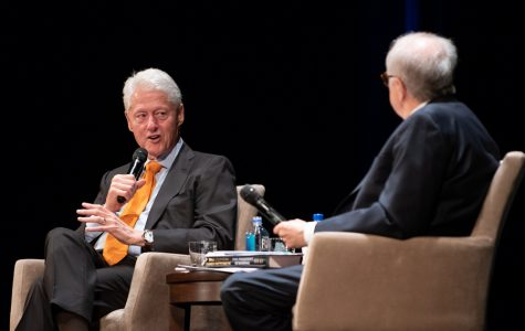 """Former president Bill Clinton speaks at the Auditorium Theatre on Thursday. He is touring the country promoting his new book, """"The President Is Missing,"""" which he co-wrote with James Patterson."""