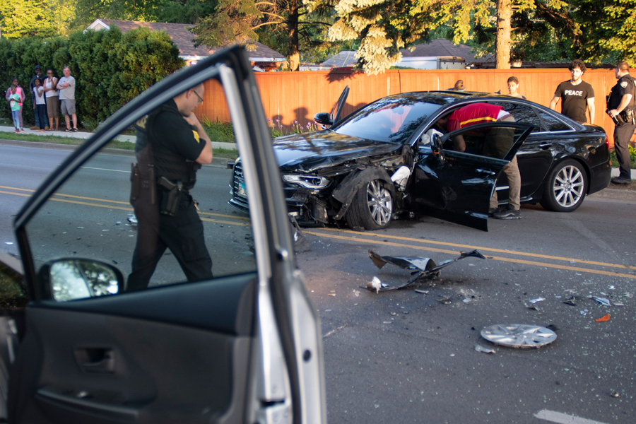 Evanston Police Department investigate a head-on collision on Monday night. At roughly 7:30 p.m., the Audi in the photo collided with a vehicle, occupied by an elderly woman, causing her multiple injuries, Evanston police Communications Coordinator Perry Polinski said.