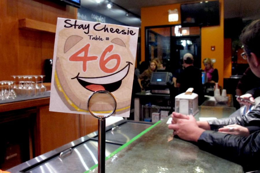 Diners order gourmet grilled cheese sandwiches at Cheesie's Pub & Grub. The restaurant announced it will close for good after midnight Friday due to rent increases.