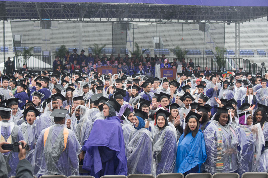 NU graduates wave to their families during 2018 commencement. The ceremony was held at Ryan Field, as scheduled, despite the rainy weather.
