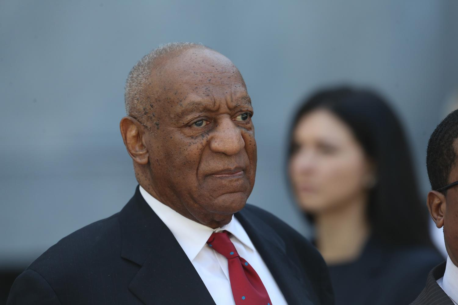 Bill Cosby walks out of the Montgomery County Courthouse on Thursday, April 26, 2018 in Norristown, Pa. after learning a jury found him guilty of sexual assault. The Northwestern Board of Trustees revoked Cosby's honorary degree Monday.
