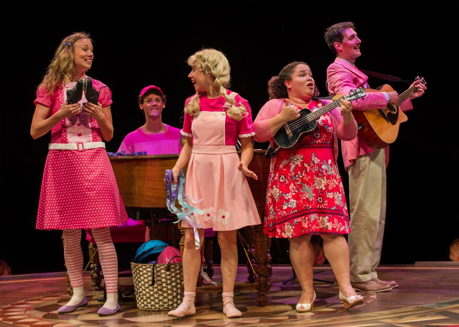 "The ""Pinkalicious"" cast performs with various instruments. The kid-friendly musical will run at the Marriott Theatre through August 19."