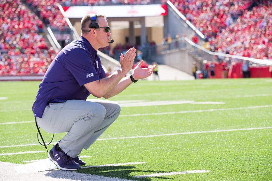 Pat+Fitzgerald+coaches+from+the+sideline.+Fitzgerald+said+he+was+optimistic+about+the+upcoming+football+season%2C+despite+a+tough+schedule.