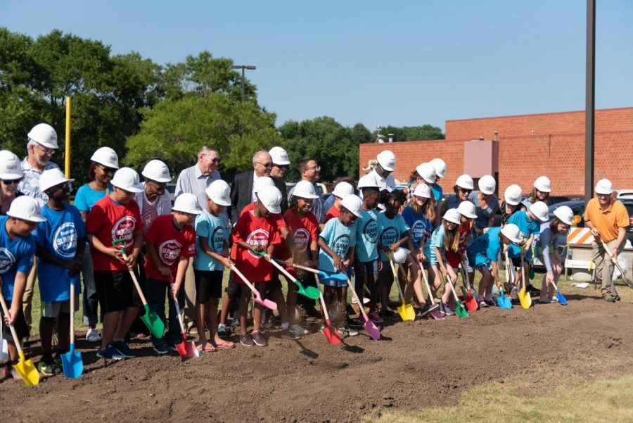 City+officials+and+kids+from+Evanston+Summer+Camps+shovel+dirt+at+the+Robert+Crown+Community+Center+groundbreaking+ceremony.+The+complete+renovation+of+the+center+is+scheduled+to+finish+in+fall+2019.+