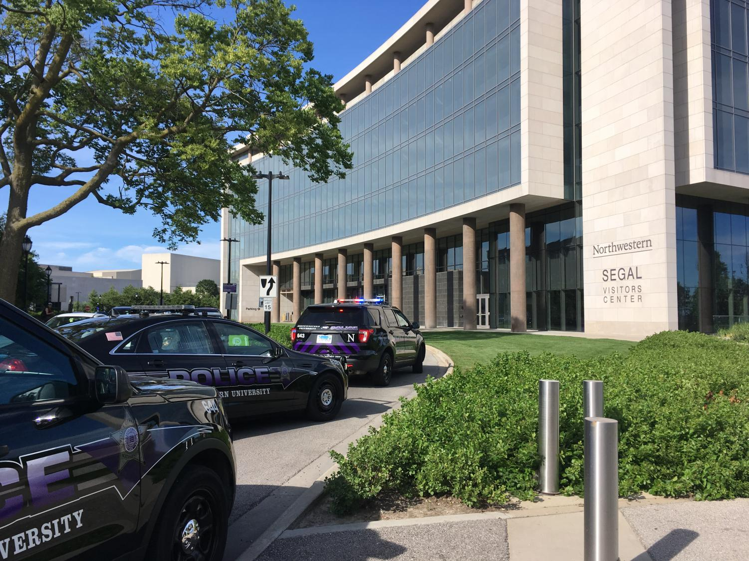 Northwestern police cars parked outside the Segal Visitor's Center. NUPD and EPD are investigating a call of a shooter on campus.
