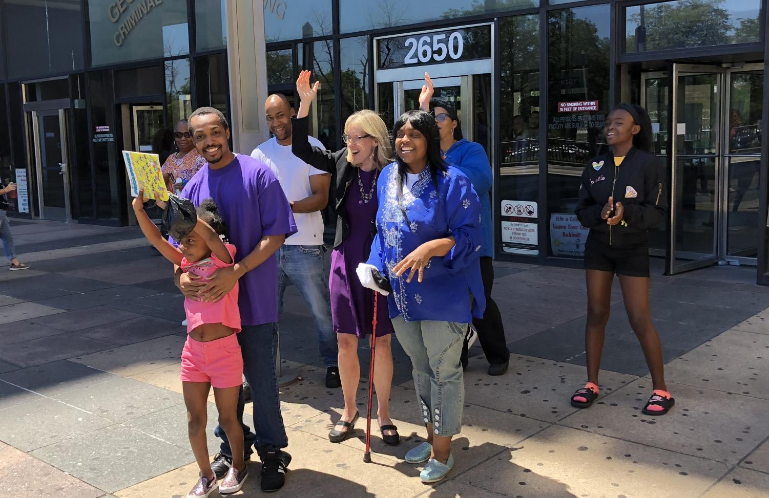 Marcel Brown (far left) reunites with his family after 10 years in jail. The state overturned Brown's previous murder charges on July 18 with help from the Center on Wrongful Convictions.