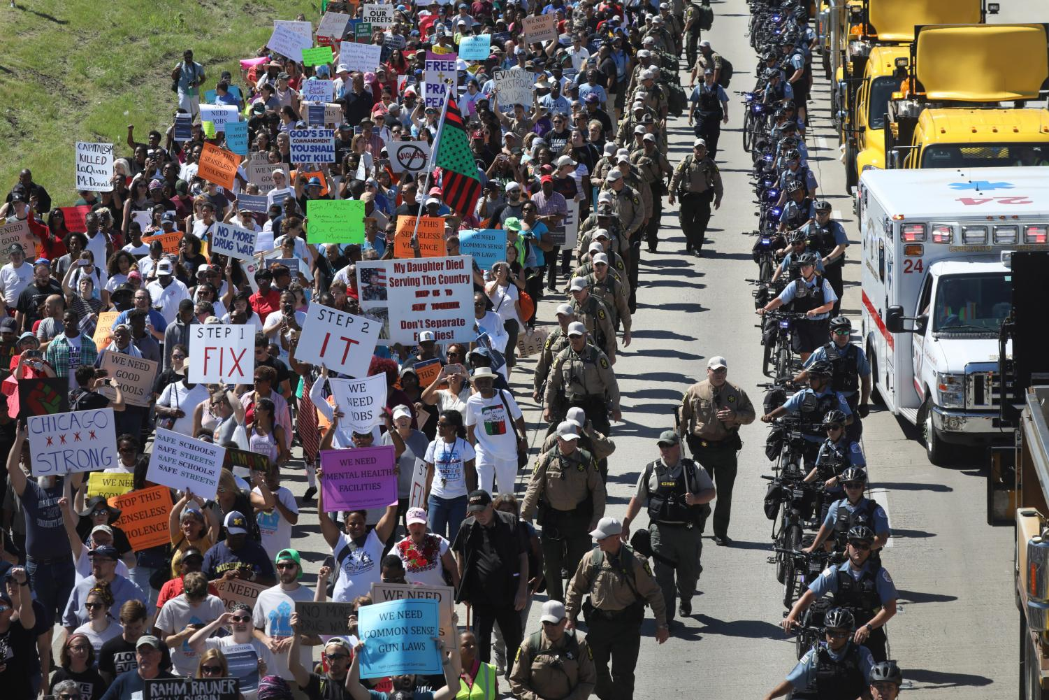 Protesters walk north on the Dan Ryan Expressway after blocking transportation in an anti-violence march. In addition to protesters from Chicago, at least 36 Evanston residents joined the shutdown in solidarity.