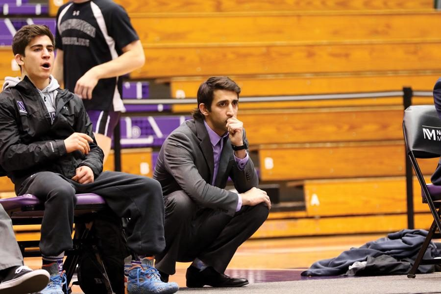 Matt+Storniolo+squats+on+the+sideline.+The+wrestling+coach+has+signed+a+contract+extension%2C+NU+Athletics+announced+Thursday.+