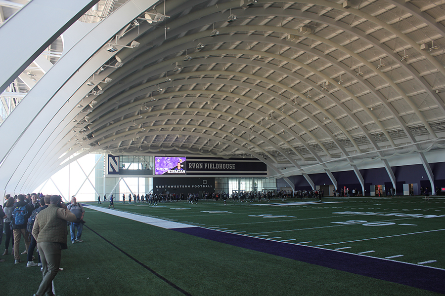 The Northwestern football team practices in the new Ryan Fieldhouse for the first time in April. The fieldhouse is part of the $270 million Walter Athletics Center, a facility that Northwestern hopes will help it keep up in the college football arms race.
