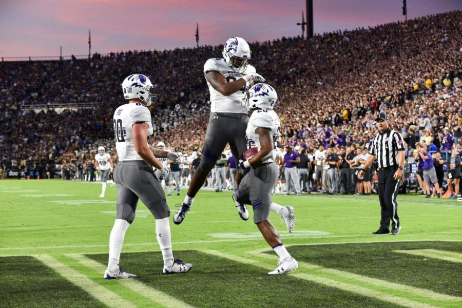 Trey Pugh (left), Cam Green (middle) and John Moten (right) celebrate a Northwestern touchdown during the Wildcats' 31-27 win over Purdue on Thursday.