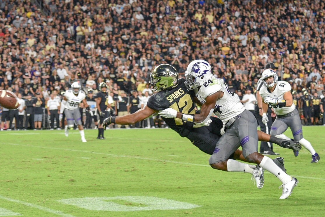 Northwestern cornerback Montre Hartage forces an incomplete pass intended for Purdue receiver Jared Sparks on Thursday night.