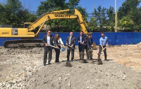 City officials and Albion Residential leadership shovel dirt at a construction site on Sherman Avenue. The new complex will feature 273 residential units.