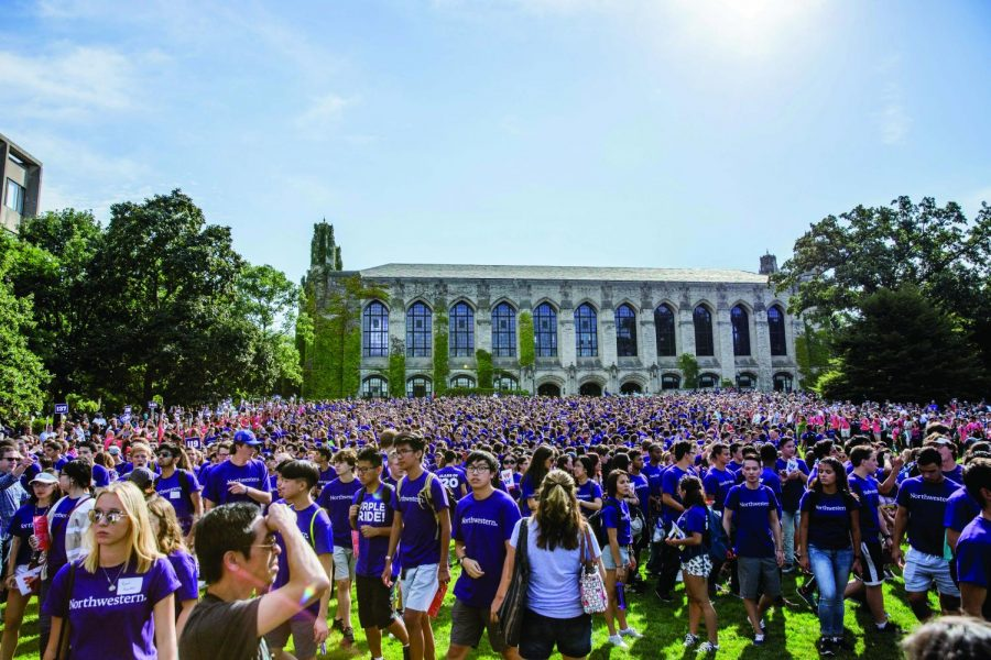 Northwestern+students+mingle+on+Deering+Meadow+following+March+Through+the+Arch.++