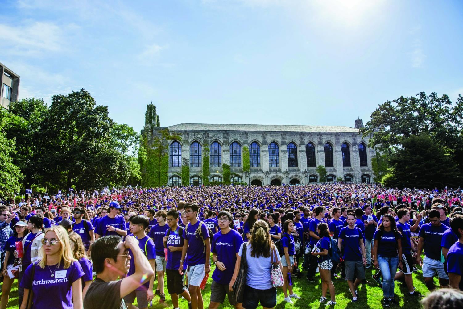 Northwestern students mingle on Deering Meadow following March Through the Arch.