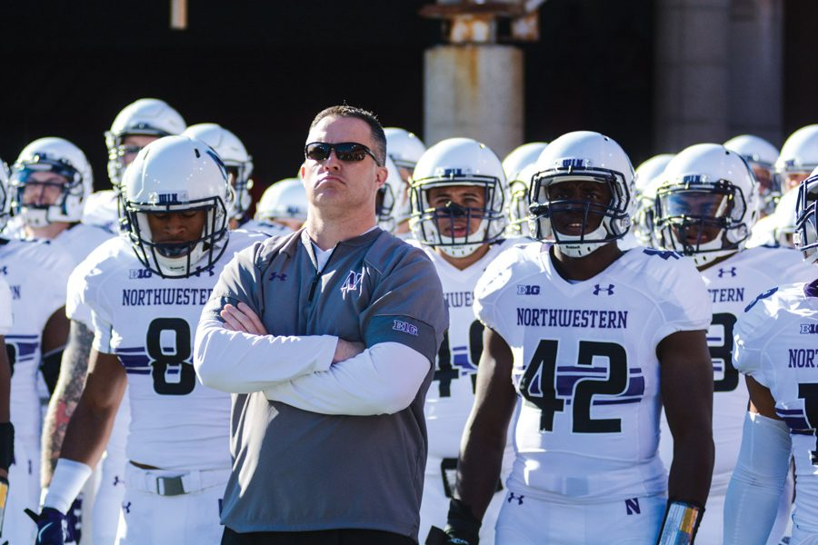Pat Fitzgerald stands with the football team before a game. Coming off a 10-3 season that featured an eight-game winning streak to end the season, Northwestern faces with an uncertain future as it heads into 2018.