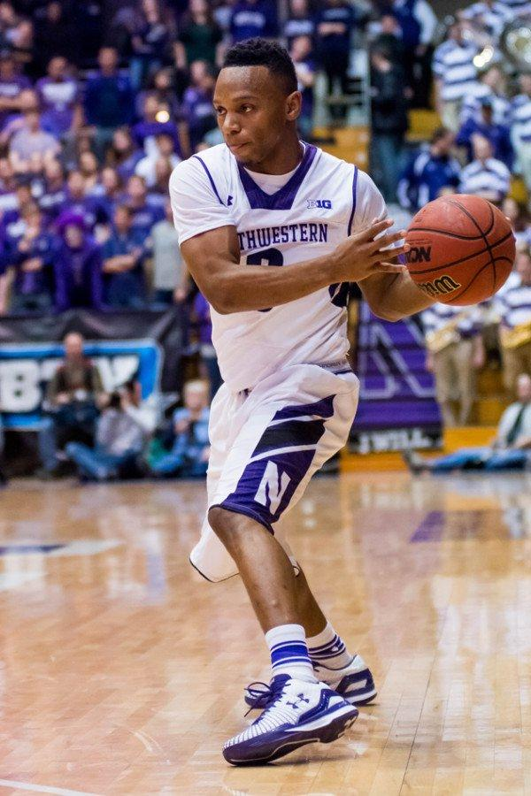 Johnnie Vassar makes a pass while playing for Northwestern basketball in 2014-15. Vassar announced his graduate transfer to Tennessee Tech earlier this summer.