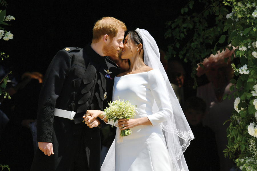 Prince Harry and Meghan Markle kiss on the steps of St George's Chapel in Windsor Castle after their wedding Saturday, May 19, 2018 in Windsor, England.